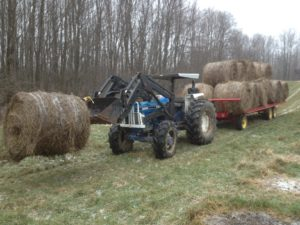 A medium sized tractor with four wheel drive can get through snow and mud quite readily.