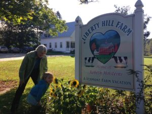 """Grandcations are popular at Liberty Hill Farm in Vermont – Farmer Beth Kennett and her granddaughter Ella at Liberty Hill Farm in Vermont, also a popular """"grandcation"""" destination. Photo by Rachel Carter."""