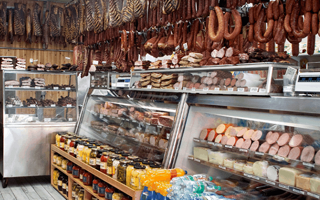 deli with hanging meat and shelves