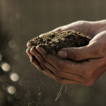 farm-hands-soil-unsplash