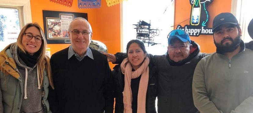 The Rosario Family Smart Farming Team (Sergio Jr, Sergio, and Silvia), Miguel Saviroff, and Nicole Waters) sharing lunch after a hard day's work.
