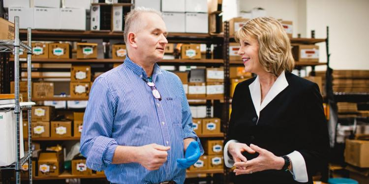 Andri Goncarovs, left, co-founder of Finger Lakes Harvest (FLH), talks with Catharine Young, executive director of the Center of Excellence for Food and Agriculture.
